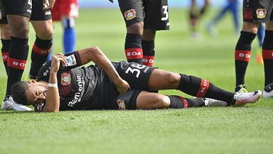 Leverkusen's Karim Bellarabi is injured and has to be replaced during the German Bundesliga soccer match between Bayer Leverkusen and Hamburger SV in Leverkusen, Germany, Saturday, Sept. 10, 2016. (AP Photo/Martin Meissner)